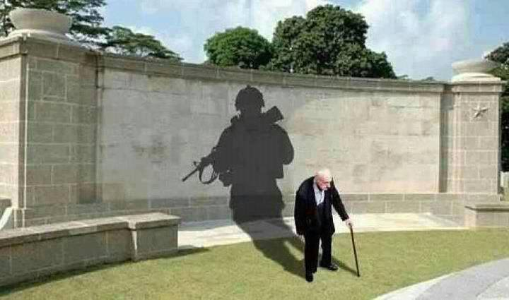 picture of old man with cane who's shadow is soldier