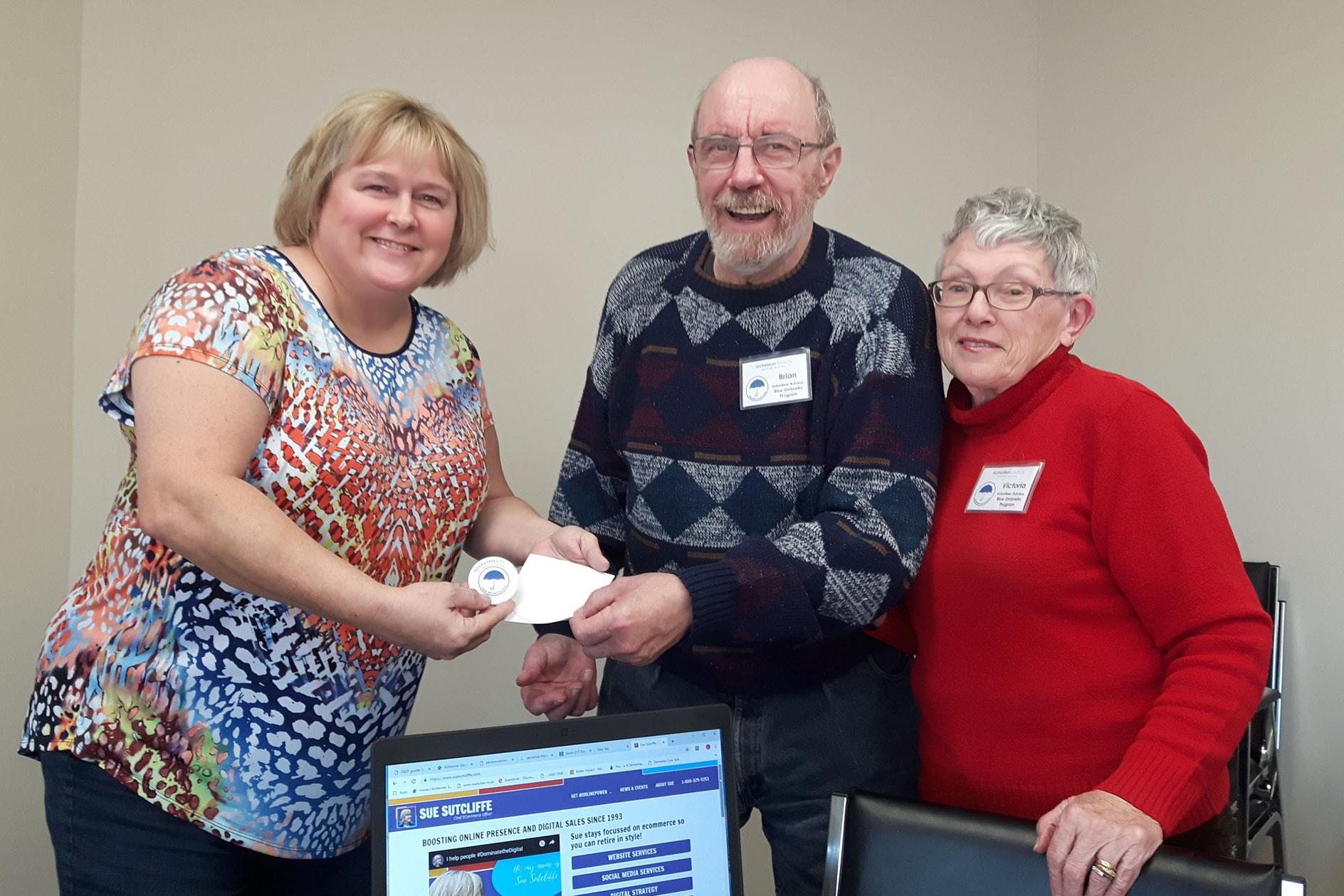 Sue Sutcliffe at Alzheimer's Society of Durham Region getting Blue Umbrella Certified