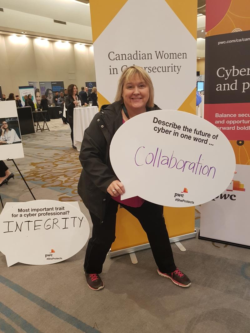 Sue Sutcliffe holding sign that says collaboration