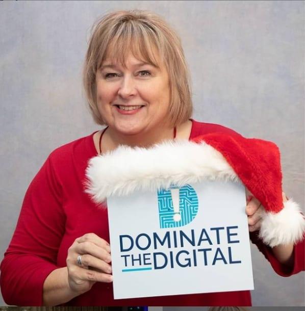 Sue Sutcliffe & DTD sign with Santa Hat